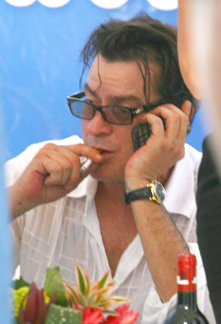 "Charlie Sheen, who recently took another jab at ""Two and a Half Men,"" looks like he's back to his partying ways enjoying a smoke in Miami. (x17online)"