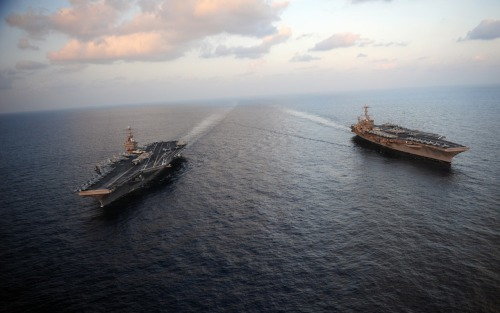 The Nimitz-class aircraft carriers USS Abraham Lincoln (CVN 72) and USS John C. Stennis (CVN 74) join for a turnover of responsibility in the Arabian Sea.(Source: navy.mil)
