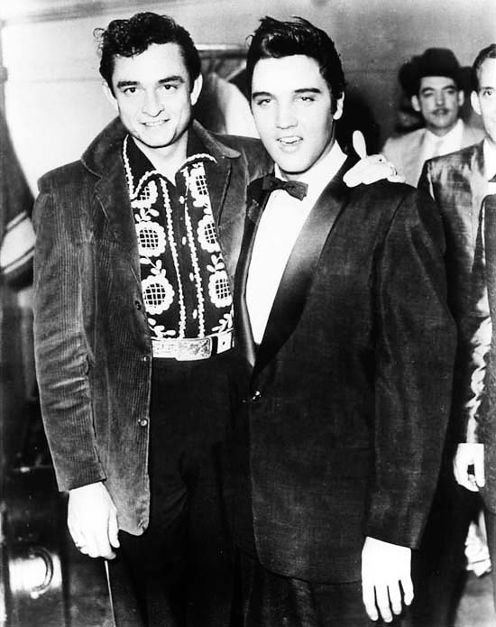 vintagegal:  Johnny Cash and Elvis Presley backstage at the Opry by Gordon Stoker. Dec 21st, 1957