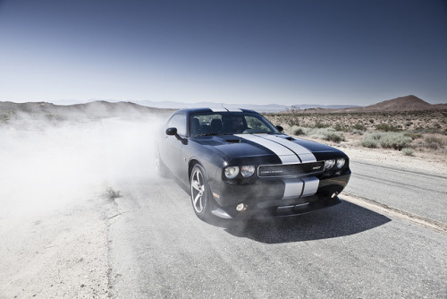 2012 Dodge Challenger SRT8 392. 6.4 Liter 8 cylinder HEMI. 470 hp. Top manual speed of 182 mph; automatic of 175 mph. 0 to 60 mph in sub-five seconds. Fully-hydraulic steering system. Image courtesy of Chrysler-Group on Flickr.