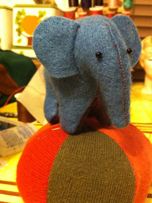 Teeny elephant made out of felt.