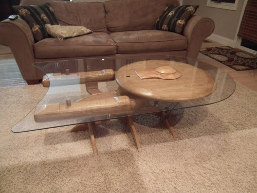 Star Trek USS Enterprise NCC 1701-C coffee table  Hand crafted from poplar, ash, and cherrywood. For a mere $3,100 you can make it so.