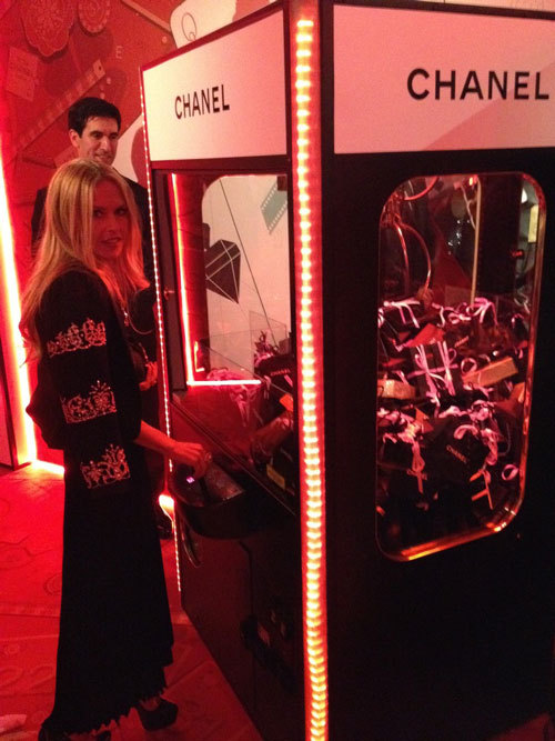 Rachel Zoe in Vegas after the Chanel show Playing with the Chanel Vending Machine *sigh*