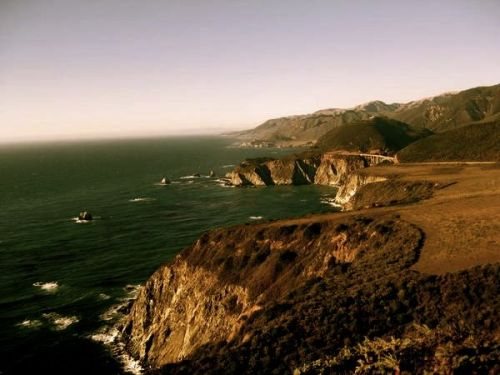 thelovelyrandoms:  Big Sur area. Ocean and wind.      I got picked up by a guy in a hippie van that smelled like something had died in a gym bag while making love to patchouli. There was only one seat and buddy listened to terrible late nineties techno-pop.   The scenery was incredible.
