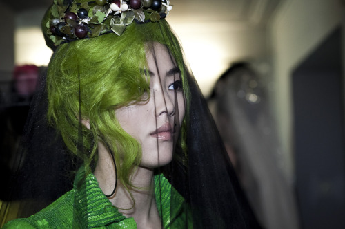 Liu Wen backstage at Jean Paul Gaultier spring 2012 haute couture.