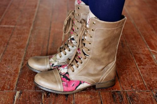 icouldmakethat:  scissorsandthread:  Floral Boots | A Beautiful Mess Boots are the only pair of shoes that I have trouble chucking when they get worn out! You can of course glitter them up (check my archives for many, many posts!) but I like this idea of adding a pretty floral fabric to them. Of course, you don't have to go with floral fabric but I personally would love these - perfect to wear in that weird in between weather with tights, a sun dress and cardigan!  I like these! They're just a tad bit 90's without being TOO 90's.