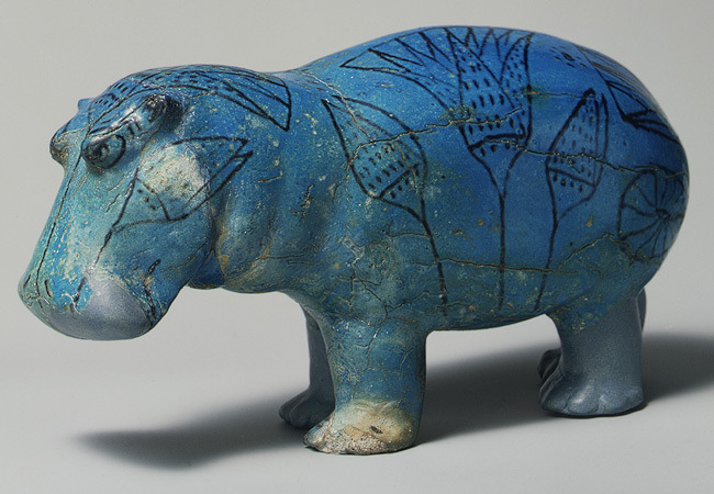 Faience statuette of a hippopotamus, Middle Kingdom - 12th Dynasty, 1981–1885 BC, Egypt.   This well-formed statuette of a hippopotamus demonstrates the Egyptian  artist's appreciation for the natural world. It was molded in faience, a  ceramic material made of ground quartz. Beneath the blue-green glaze,  the body was painted with the outlines of river plants, symbolizing the  marshes in which the animal lived. - metmuseum.org
