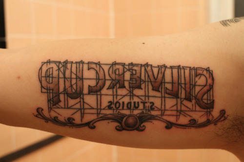 Here's my second and newest tattoo.  It's the Silvercup Studio sign in Long Island City in Queens.  I've always been a big fan of signage, especially older signage and this is a great example of one.  When I cross the Queensboro Bridge or ride the train, I usually pass it on the back side.  I rarely see it from the front, so that's why I had the tattoo done this way.  Plus it reads forwards when I see it in the mirror. The tattoo is done by Dan (Bones) Bonara from Twelve28 Tattoo in Williamsburg.  Great guy and awesome work, as you can see here.