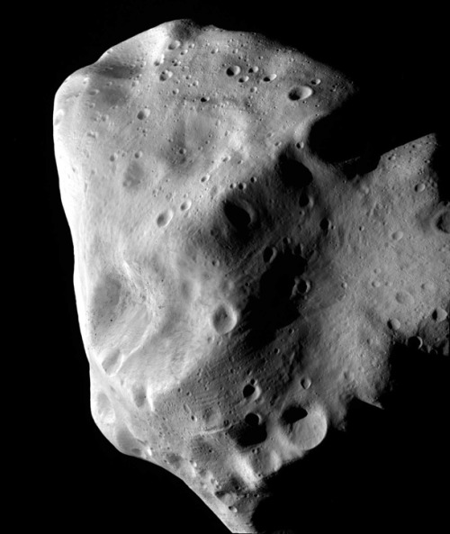 "OMG!…it's LUMPY (at) SPACE PRINCESS!!!""On July 10, 2010, the European Space Agency probe Rosetta passed just 3162 km (1960 miles) from the asteroid Lutetia, a lumpy rock 130 km (81 miles) end-to-end.  This image, taken at closest approach, shows how battered and worn Lutetia is. Craters pockmark the surface, including several that are many kilometers across. Like the Martian moon Phobos, grooves line the surface, which may be from boulders rolling around, perhaps ejected from some of the craters when they were formed. They may alternatively be stress fractures from impacts; there is still a lively debate over what causes these features in small bodies. "" more @badastromer:http://blogs.discovermagazine.com/badastronomy/2012/01/26/rosettas-stunning-mars/"