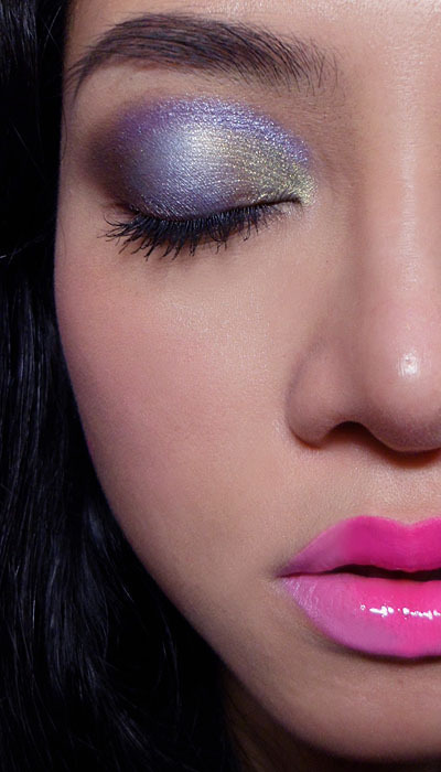 makeupbox:  Young Hearts: Colorful Lids and Sakura Lips —- Step 1: Apply a deep chocolate brown (The Body Shop Eye Shadow #32) to the outer corners in a V shape (one leg along the lash line and one along the socket line. If you have a mono-lid, do this with your eye half open and feel for the socket line. It should be on top of your lid fold, and just visible when your eyes are open.Run along the outer halves of the lower lash line as well. —- Step 2: Apply a pale blue (The Body Shop Eye Shadow #17) from the gap in the brown outer V, inwards just past the center of the lids. —- Step 3: Fill in the inner portions of the lid with a pale gold pistachio green (The Body Shop #44) —- Step 4: Then use a pencil brush, run a slightly deeper blue purple like Lime Crime Twilight along the socket line from inner corner outwards in an arc until it reaches the brown at the outer corners. —-  Step 5: Add a bit more chocolate brown if it has faded a bit from applying the pastel blue earlier.—- Step 6: Apply black mascara and a pale white/beige/yellow pencil along the water line. —-  The finished eye should look colorful and fun, but still light and pretty. Note that there is very little blending done. You don't want to muddy up the colors by sweeping a big brush all over the lids area. Just make sure the border of each color sort of blends into the next. —- Now, for the crazy lips! I wanted to do a stained lip, but not something that looked like the usual red/berry on nude combination. I figured I could do 2 cool-toned pinks instead.  —- First begin by priming your lips with a light layer of concealer in the center of the lips, around the cupids bow.  Then use a flat brush with a rounded head to pack on neon pink pigment and press it diagonally into the lip, so that you form a rough heart-shaped top. Repeat until the color builds up to a strong neon pink. —-  You will end up with this at the end. The harder part: Use a lip brush to carefully paint in a pale milky pink (Lime Crime Great Pink Planet or MAC Saint Germain if you are in Europe) over the rest of your lips. —- You can stop here if you want! But I gently topped the lips with gloss, and then smudged out the edges of the darker pink a little so it would look a little softer and more grown up. EASY WAY OUT: Just replace the pigment used to create the neon pink heart with a lipstick like Barry M 52 Shocking Pink or Lime Crime Countessa Fluorescent.