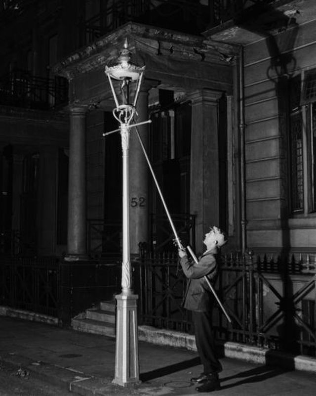 LAMPLIGHTER, KENSINGTON, CIRCA 1930  BRANDT, BILL (1904-1983)