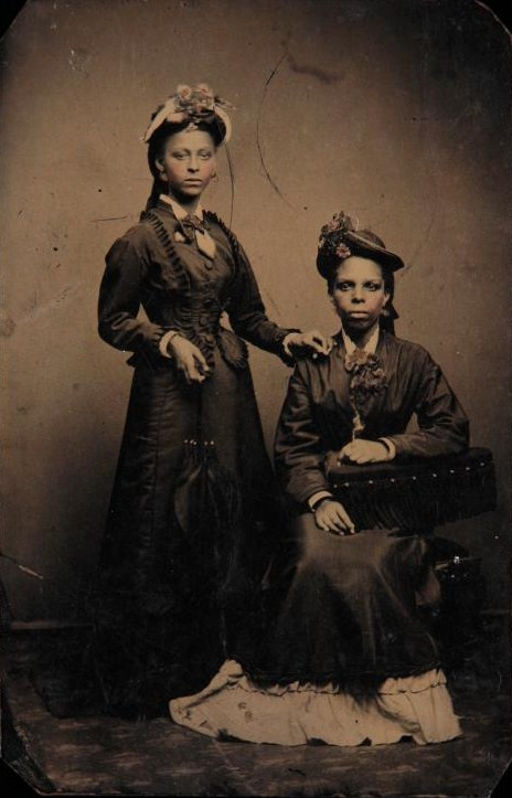 vintageblackglamour:  holdthisphoto:  Tintype of James Weldon Johnson's mother and sister: Helen Louise Johnson and Agnes Marion Edwards, 1870  Tintype of James Weldon Johnson's mother and sister: Helen Louise Johnson and Agnes Marion Edwards, 1870.