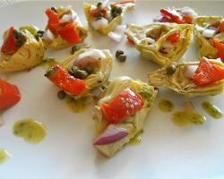 mothernaturenetwork:  Recipe: Artichoke and Capers Salad Hot, cold, served on a plate or tossed in a salad, this versatile dish is lip-smackingly good with chilled chardonnay.