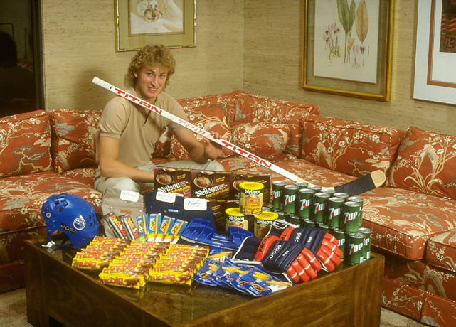 Today is Wayne Gretzky's 51st birthday. In this 1981 photo, Gretzky poses in his Edmonton home with sticks, helmet, equipment, and other products he endorses. (Paul Kennedy/SI) GALLERY: Rare Photos of Wayne GretzkySI VAULT: Gretzky, 17, tearing up Edmonton (12.11.78)
