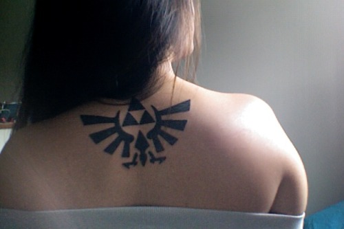 My first tattoo. Zelda is much more than an innovative and beautiful game to me. My sister and I would sit and watch my brother play for hours. Even when we'd bicker on what to do in a temple..we'd all shut up during a cinematic.It has created a bond between three siblings — even during some pretty rough times. Wisdom, Courage, and Power. Each possessed by a brother and sister. Even now, all three of us are in our 20s…and the release of Skyward Sword has brought us back together; my sister and I sitting on the floor watching my brother play as Link once more. Zelda has created memories and bonds with the only siblings I have. Even though we fight when I'm home for only two seconds…having this on my back reminds that family is forever.  www.alice-kim.tumblr.com