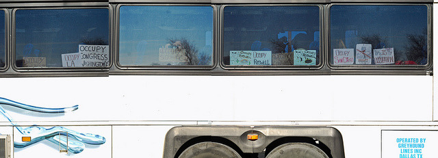 Road2Congress | Occupy Greyhound Bus on Flickr.Via Flickr: Signs occupy the Greyhound bus across the country to Washington D.C. for the January 17 Occupy Congress event.  (Johnny Nguyen)