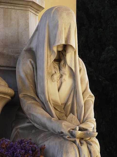 "seventh-victim:    A ""weeper"" was a statue that was meant to mourn eternally at the grave of a loved one.  (Note: This statue is at a grave in Verano Monumental Cemetery near Rome, Italy.  Work on the cemetery and its numerous statues began in 1811 and new work began in 1859 based on a plan by Virginio Vespignani. Major Roman and Italian architects and sculptors are represented here.  Vespignani, 1802-1882, was a major Italian architect who served as a papal architect and who designed gateways and building facades in and around Rome. — Shades and Shadows)"