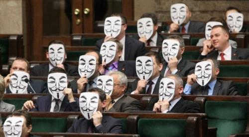 thedailywhat:  Photo of the Day: Members of the Polish opposition party Palikot's Movement held up Guy Fawkes masks in the Sejm today to protest their government's recent passage of the controversial Anti-Counterfeiting Trade Agreement (ACTA). [reddit.]