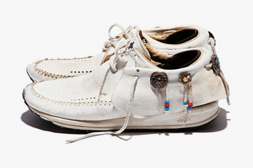 GORO'S X VISVIM FBT BY HIROSHI FUJIWARA With the Native style in full force, it's hard to find compelling work in fashion design that doesn't get lost in a sea of sameness. But this three-part collaboration puts Japan-based accessories purveyor Goro's unique Native American-embellished jewelry on the silhouette's customary leather collar. Fujiwara put his finishing touch on the project with chromatic beads on tassels of the FBT's upper paneling. In three basic colorways, you can check out the shoes now at kiDulty.
