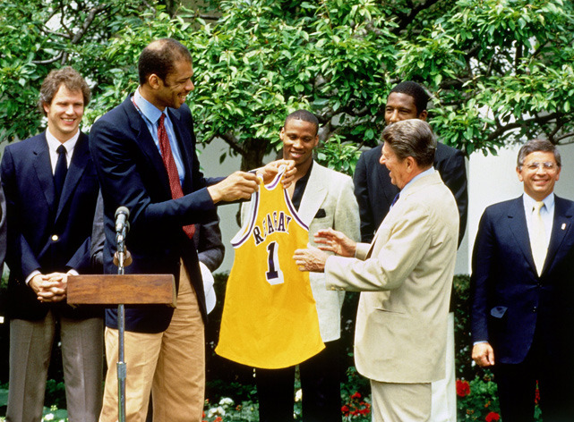 Lakers center Kareem Abdul-Jabar presents President Ronald Reagan with an honorary jersey during the world champion Los Angeles Lakers visit to the White House in 1985. (Photo by Andrew D. Bernstein/NBAE via Getty Images) GALLERY: Athletes Visiting The White House