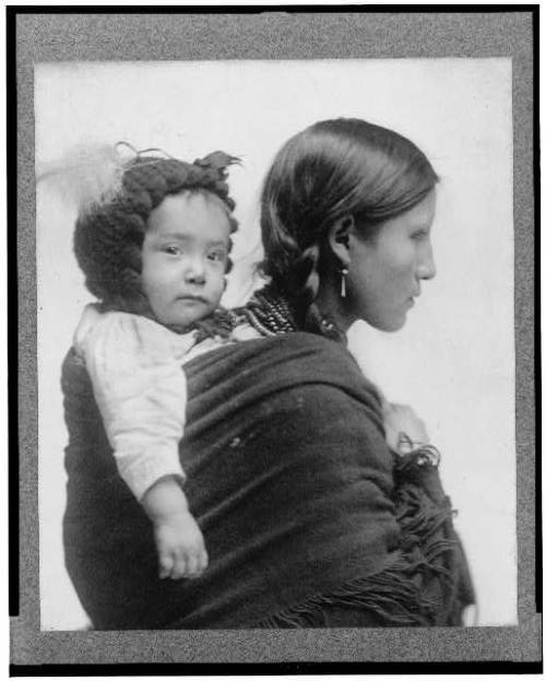 (via [Native American woman from Plains region, half-length portrait, facing right, with baby on her back])