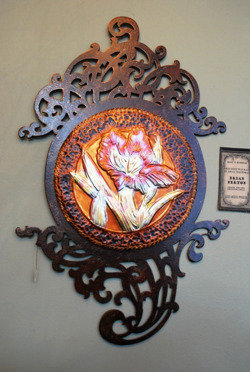 """Iris"" wall hanging in copper and metal by Nancy Derton."