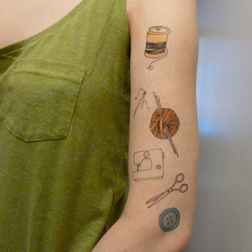 The awesome thing is that these are crafty fake tattoos.  The more awesome thing is that I already have a real yarn ball + thread spools tattoo, and am looking forward to continuing my sleeve with all of the pictured items (replacing the needles with a hook of course). <3 NYAH This is my sleeve in progress.