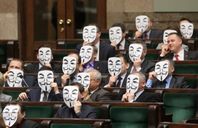youranonnews:  In protest of ACTA, Polish Parliament members wear Anonymous Guy Fawkes masks in chamber on 26 January 2012.
