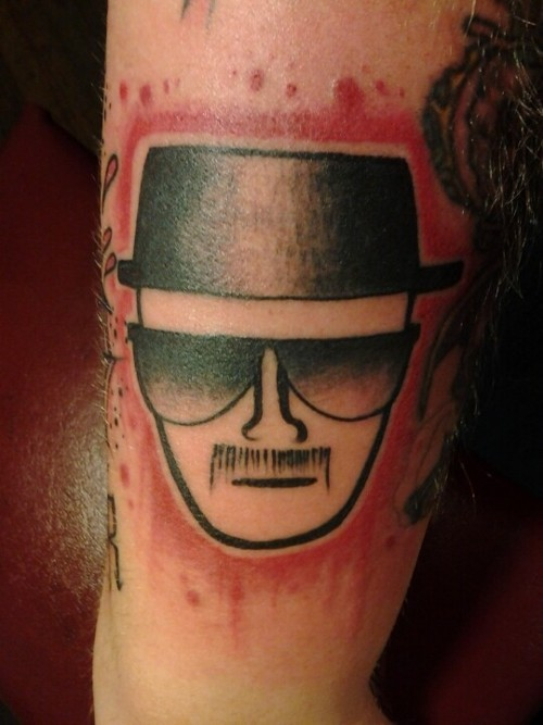"A ""Breaking Bad"" tattoo. It may simply be the best TV show of all time. But not sure what message you're sending if you've got Heisenberg's face adorning your arm. Via fuckyeahtattoos"