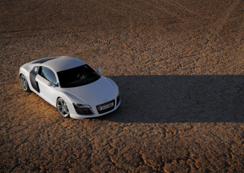 "2012 Audi R8.  4.2 Liter 8 cylinder engine.  420 hp at 7,900 rpm.  316 lb-ft. at 4,600 rpm.  Uses the mid-engine Lamborghini Gallardo platform.  0 to 62 mph in 4.4 seconds.  11 city miles to the gallon; 20 highway miles to the gallon.  19"" 5-arm-double-spoke-design aluminum alloy wheels with summer performance tires.  Image courtesy of leftlanenews.com."
