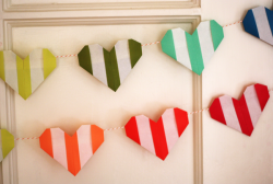 Make a striped origami heart garland.