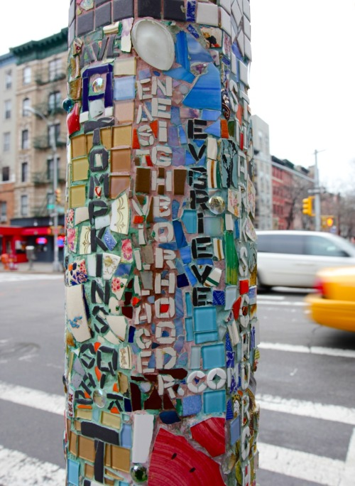 sometimesatourist:  East Village  (By Mosaic Man)  Jim's made some nice progress on his latest pole on 2nd Ave and St. Mark's Place. Here, he gives a shout-out to local bloggers Neighborhoodr and E.V. Grieve. Stop by the pole to see who else Jim gives some love. If you do walk by, take a picture and ping Jim on Facebook or Twitter @MosaicManNYC, or just submit a post right here.