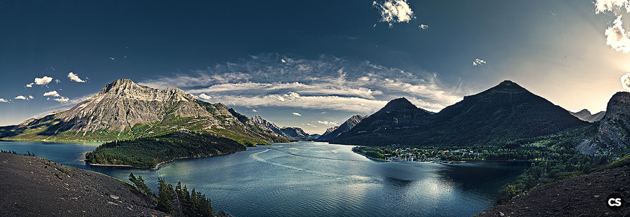 some of the last rays of direct sunlight over the classic view of waterton/waterton lakes park seen from the lawn of the lodge. i was quite taken by the dichotomy of the light rays and dramatic shadow contrast to my right and what looked like the middle of the day on my left. 180 degree panorama stitched from 34 individual photos.