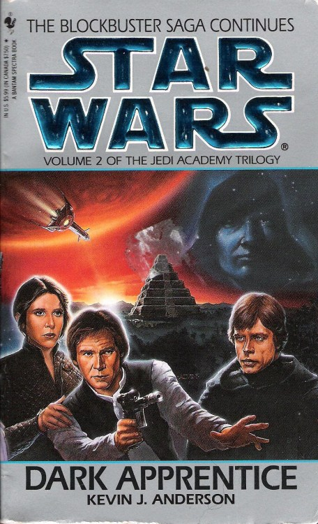 Dark Apprentice by Kevin J. Anderson (1994, Bantam) The second Jedi Academy novel, Dark Apprentice, opens in a state of relative calm and general hunky-doriness. The deadly and indestructible Sun Crusher is launched into the center of the gas giant Yavin where it can't be retrieved, and Luke has about a dozen students that he's begun training at his new Jedi Academy, located on Yavin IV in the ancient temple and former Rebel base there. Unfortunately for Luke and all the others, Dark Apprentice follows the generally agreed-upon storytelling rule that in the second part of a trilogy, everything has to go to hell in a hand basket.  Just for starters, sabotage causes Admiral Ackbar's personal B-wing to crash into a culturally important cathedral on a planet the New Republic is courting. Ackbar survives, but, believing the crash to be his own fault, resigns his command in disgrace.  Imperial Admiral Natasi Daala takes her surviving fleet on a mission to cause as much damage to the New Republic as possible. This includes wiping out a new colony on Dantooine along with every one of its inhabitants, followed by a devastating attack on Mon Calamari.  But the biggest threat lies on Yavin IV. We learn that the jungle moon is haunted by the spirit of a powerful Sith lord, Exar Kun, who lived four millennia ago and sparked galactic war. Kun's spirit succeeds in killing one of Luke's apprentices and seducing another: young Kyp Durron.  Durron, believing himself wise enough to use the dark side's power for justice, decides that Luke is too weak to do what is necessary. With Exar Kun's help, he drags the Sun Crusher out of Yavin's core and makes off with it, vowing retribution for those who still serve the Empire that destroyed his childhood. He even manages to do something to Luke, leaving the Jedi Master catatonic and the apprentices to fend for themselves.  Kyp Durron's fall to the dark side is believable; he has plenty of reason to be angry, and even if I hadn't already known what was going to happen to Kyp, I think I would have seen it coming. Still, while his motivations are logical and Kyp's way of rationalizing his descent into evil rings true, I can't escape the feeling that it happens just a bit more quickly than what seems likely for such a momentous decision in a person's life.  Dark Apprentice isn't all doom and gloom. There's a delightful subplot in which Han and Lando's dispute over who rightfully owns the Millennium Falcon comes to a head. The two of them play sabaac for it, and the ship changes hands three times before Lando gives it to Han as a gift—whether because he's such a great friend or to impress Mara Jade is unclear. This goes a long way towards keeping this book from getting too grim.   Wedge Antilles even gets to enjoy a budding romance with Qwi Xux, the Imperial scientist who escaped with Han, Chewie, and Kyp from Maw Installation. The relationship seems a bit unlikely due to the fact that Qwi is partially responsible for those two Death Stars Wedge helped blow up, but the passages that follow them on their trip to the forested planet of Ithor are heartwarming, if for no other reason than that it's nice to see Wedge this contented—but even this culminates in disaster.  With Dark Apprentice, Kevin J. Anderson delivers a solid second installment to this trilogy that tops the first. The notion of an evil Force ghost is a fascinating one, and Exar Kun's seduction of Kyp Durron reads a little like a Bizzaro version of Luke's relationship with post-mortem Obi-Wan. Kyp himself makes a great villain because he plays on all of Luke's insecurities about his ability to train Jedi. He flat-out accuses Luke of not knowing what he's doing and, by turning to the dark side, fulfills Luke's greatest fear. The book certainly ends with enough loose threads to entice the reader to pick up the Jedi Academy Trilogy's final chapter, Champions of the Force. We'll check that one out next week.