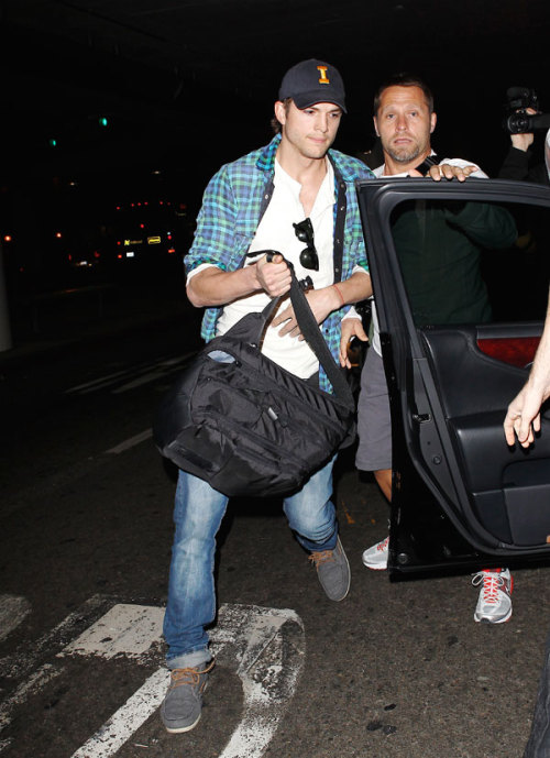 Ashton Kutcher was snapped rushing to estranged wife Demi Moore's side after learning she was hospitalized. Kutcher was in Sao Paulo for Brazilian fashion week. For the latest Demi news from Fox411.com, click here. Click here for more Ashton photos from X17Online.com