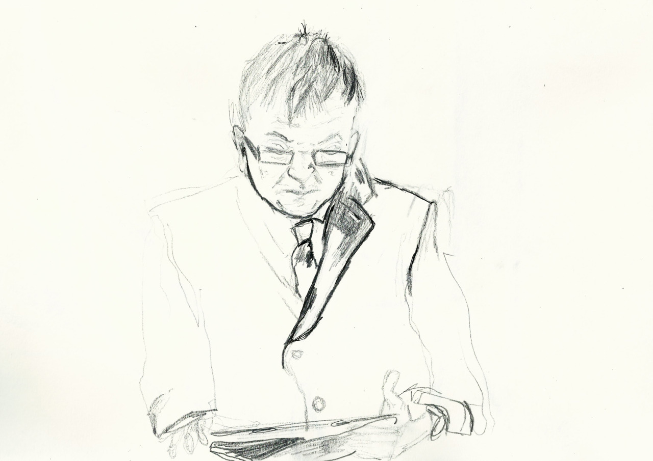 Man reading his iPad on on the train. 27/01/2012