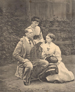 Charles Dickens and his two daughters.