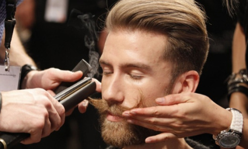 theweekmagazine:  A model gets his mustache groomed in preparation for the Patrick Mohr show at Berlin Fashion Week. This week's best photos