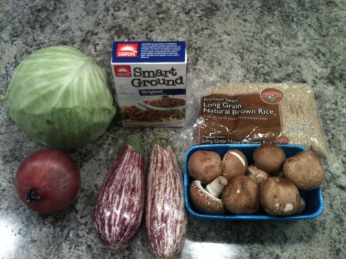"moonbehindclouds:  motivationforfitness:  Tonight's vegetarian supper was a delicious attempt at creating a vegetarian version of something my mom used to make when I was a kid. (I'll give the omnivorous version at the end.) This is not a fast meal, but it is totally worth it. Prep time is about an hour. You will need: 1 cup long grain rice (any kind will do) 10oz bella mushrooms 2 small graffiti eggplants 1 package of smart ground original ""beef"" 1 red onion 1 cabbage 5 cloves of garlic Get a large pot of water on the stove and a medium pot of water on the stove ready to boil while you prepare. Cut your cabbage deep all the way around the core. No need to remove it, but go in there at least 2 or 3 inches. Place core-down into the simmering water (or a very gentle rolling boil) in the large pot. You will need to flip it occasionally if your pot isn't large enough for the cabbage to fully submerge. Place your 1 cup of long grain rice into the medium pot to cook. Do not cook the rice all the way. It should still have a bit of a tough center and should be loose (not sticky.) Chop your eggplants, onion, mushrooms and garlic and saute them in a large frying pan with very little oil. (As little as possible. Spray oil works best.) Place the sauteed veggies into a bowl with the mostly cooked rice and crumble the full (cold) package of fake ground beef into it. Mix well. Peel the cabbage leaves gently from the cabbage using tongs. They should peel away easily (you may have to do this in shifts as the center leaves cook slower.) Stuff the leaves, roll them shut and stack in a pyrex dish. Bake, covered, on 375 for ~45 minutes (this depends on how done your rice was when you mixed it in.) Serve hot with ketchup. (Yes, ketchup. I promise it's not weird!) For my meat eaters, ditch the veggies and mix ground pork and beef (cooked) in with the rice. *EDIT* I submitted the recipe into my calorie counter website and posted the actual daily values for you to see.  Yummy!  Okay, last post for the night. Meant to go to bed over an hour ago. Oops"