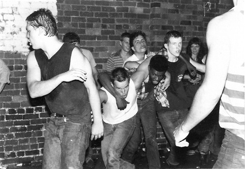 laughingsquid:  The Daily Show's Jon Stewart Moshing at a 1982 Dead Kennedys Show  Oh man this is really great.