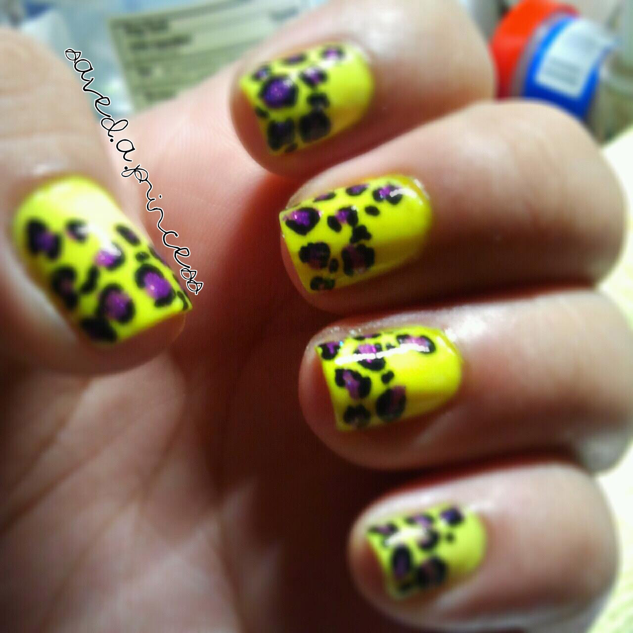 Neon yellow nails with purple glitter leopard print