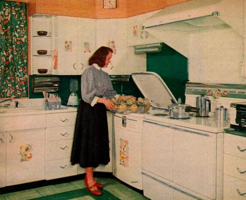"the50s:  ""A Living Kitchen""  ""Fran's dishwasher is between a double-oven electric range and a corner base cabinet adjacent to the sink. A ventilating hood over the range eliminates cooking odors. The metal cabinets are decorated with bright decals."" ""Family Circle Magazine""June 1955"