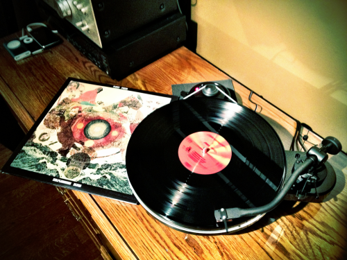 torvaindustries:  Fleet Foxes Helplessness Blues came in the mail today.  What table is that? It's beautiful. (And don't skimp on the details, if you have them. I'm due for an upgrade soon, and if that's not $1000 or more it might just be the winner) That's a Pro-ject debut RPM 1.3 mounted with an Ortfon 2M Red Moving Magnet Cartridge. It is available from NeedleDoctor.com for right around $500.  Looks like I have a reason to start saving money again. (my realistic system is jealous)