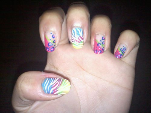 "these are my ""Lisa Frank Explosion"" nails lol"
