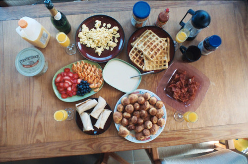 Scrambled eggs, biscuits and gravy, belgian waffles with fresh fruit, honey oat and peanut butter rolled bananas, crispy bacon, and champaign mimosas to accompany.