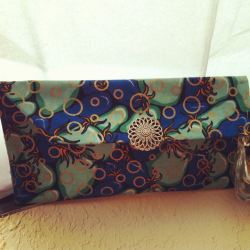 Hand stitched clutch bag made with African print…