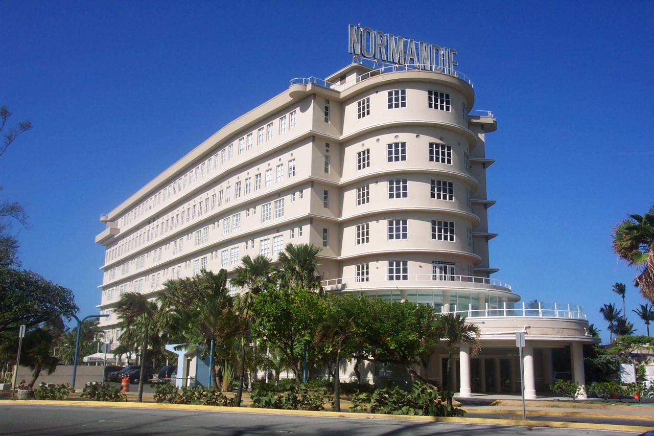 The Normandie Hotel is a hotel located in San Juan, Puerto Rico. The hotel originally opened on October 10, 1942. Its design was inspired by the ocean liner SS Normandie. It features the same art deco design as the ship that inspired it, and the hotel's roof sign is one of the two signs that adorned the top deck of the Normandie but were removed from it during an early refitting.