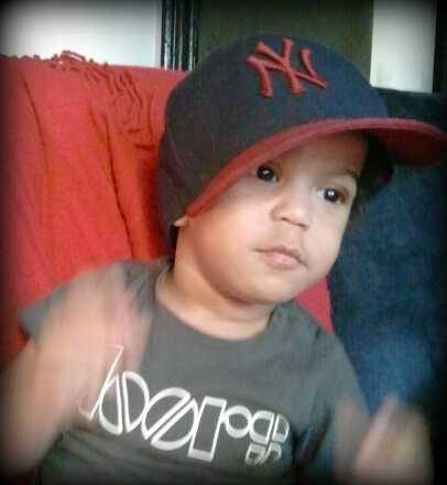 My baby playing with Daddys fitted…