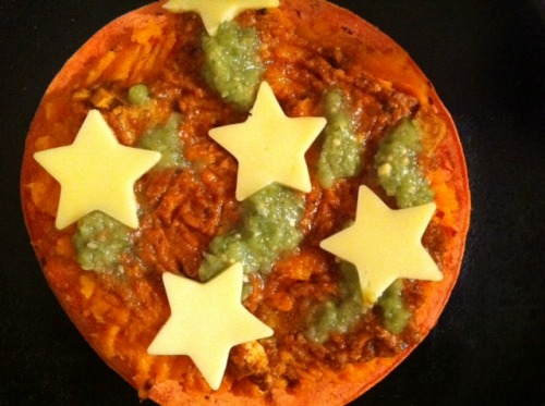 Sweet Potato Tikka Pizza! This is a mini-pizza that happens to be GF (as long as the mystery chunk of faux-cheese doesn't have some hidden gluten, anyway.) It is a chile corn tortilla lovingly sauced with mashed sweet potato, then gently topped with a spicy sweet-potato-and-tofu tikka masala, then further accented by tangy green tomatillo salsa and the end of nameless vegan cheeze coaxed into star shapes for the kids. This is what leftovers look like at our house on a good day! It is hot, creamy, sweet, sharp, spicy, crispy, chewy, and just dang delicious. Submitted by A. & Ayuh! (We modified this for a vegan tikka masala: http://www.food.com/recipe/chicken-tikka-masala-25587) (US/Cananda submission) This contest is awesome, btw! [This is only the most adorable pizza I've seen in, like, FOREVER! Kids are lucky, they get all the cute foods! - ed.]