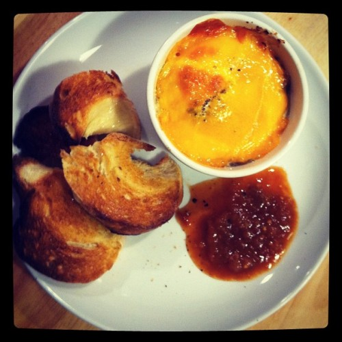 wcfoodies:  Cookbookin'! Egg en cocotte on fried potatoes, topped w/cheddar. Homemade challah toast, pumpkin-chipotle salsa. (Taken with instagram)
